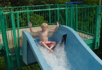 Boy Sliding Down a Water Slide