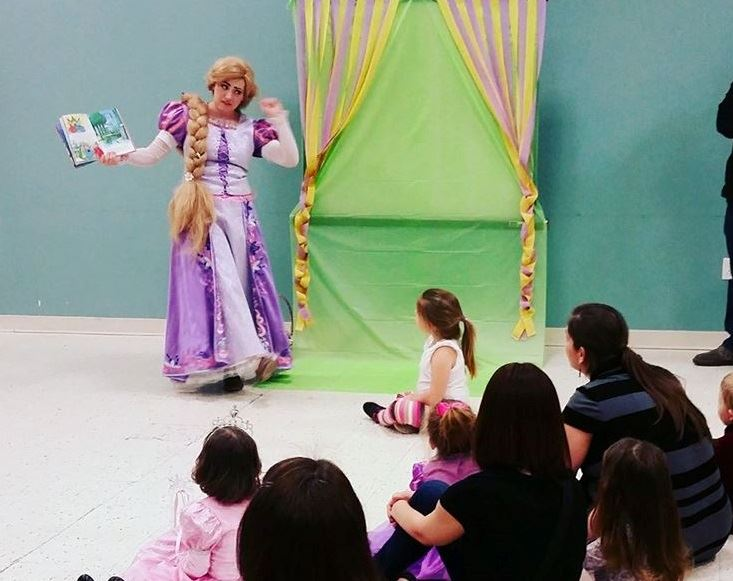rapunzel reading book to children at riverchase recreation center
