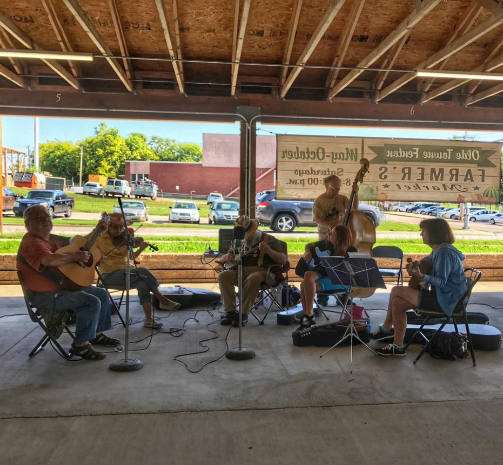 band playing music at farmers market
